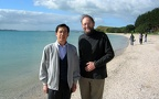 Professor Sun Youzhong, Dean of the School of English and International Studies BFSU and Professor Nick Perry on Maraetai beach