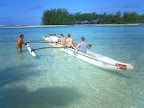 Boys learn to paddle a vaka ama